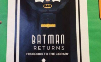 Batman Returns his books to the library